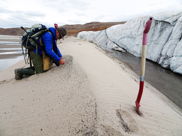Kurt Kjær collecting sand samples at the front of Hiawatha Glacier.