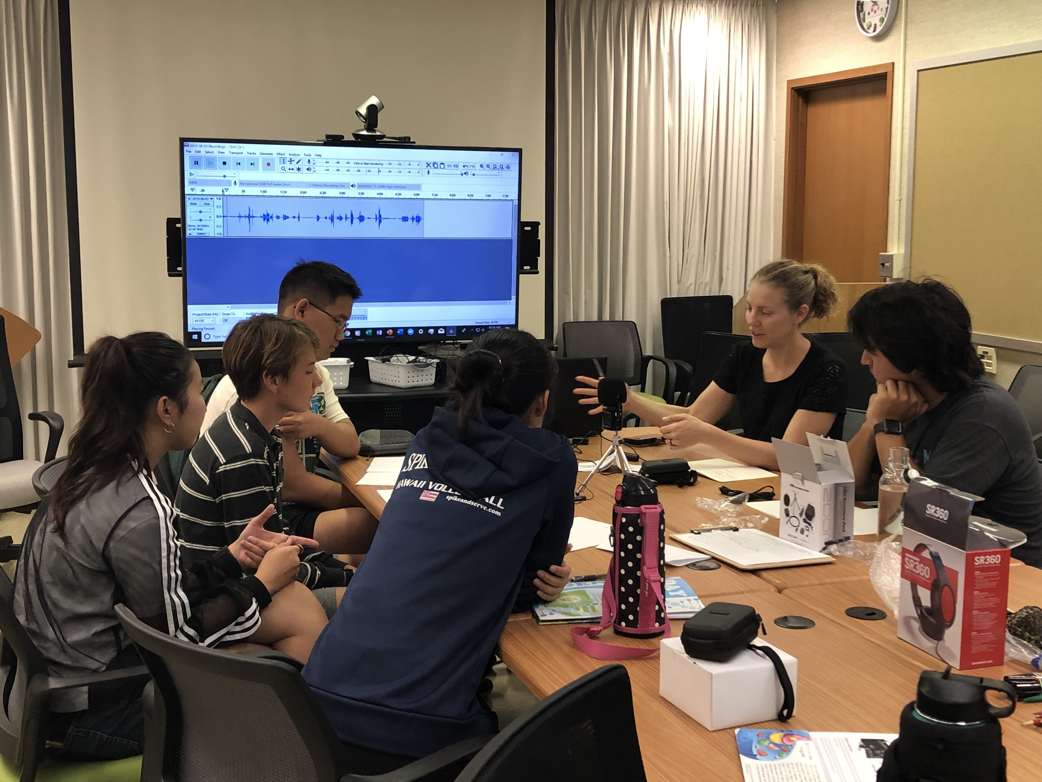 High-School students interviewing University of Hawaii scientists for local radio