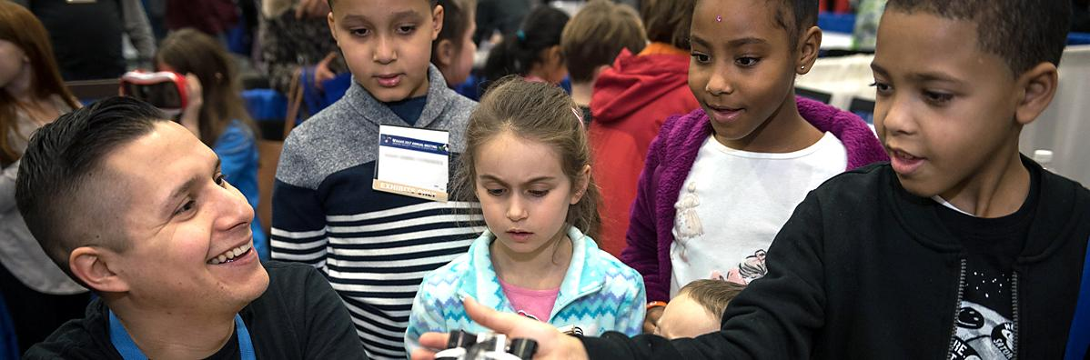 Children interact with a scientist during Family Science Days at the 2017 AAAS Annual Meeting.