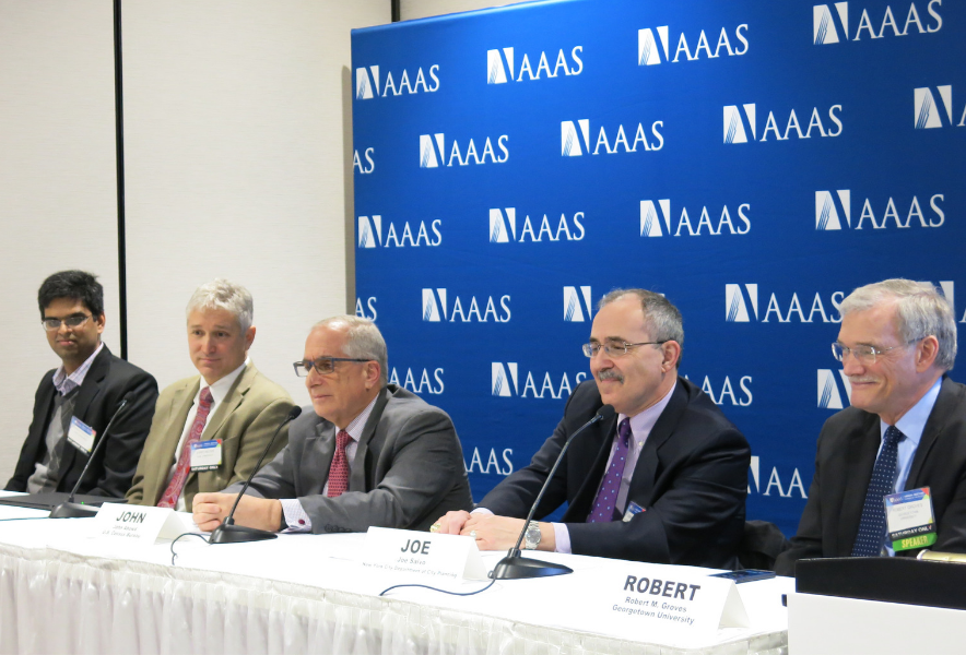 Five panelists in front of a AAAS backdrop