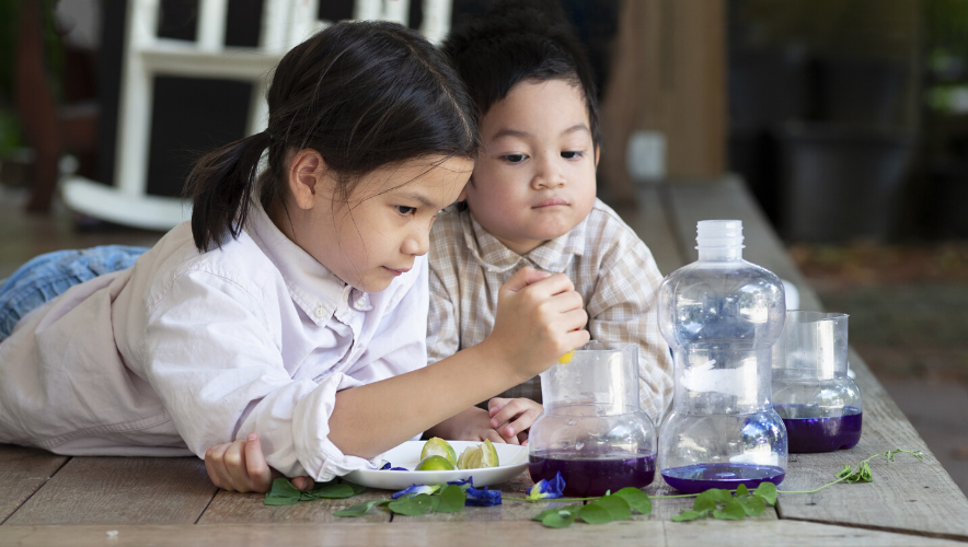 Two children conduct a science experiment