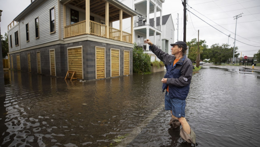 """Tony Bartelme tests floodwaters for fecal contamination for his """"Rising Waters"""" series in May 2020"""