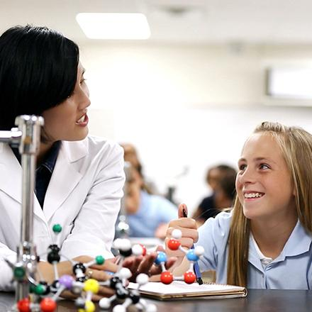 Scientist with student