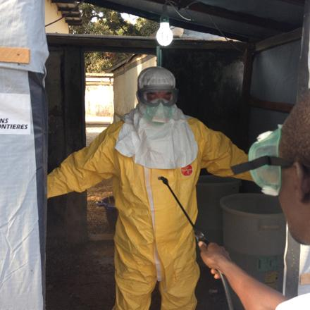 disinfecting Ebola workers in Guinea