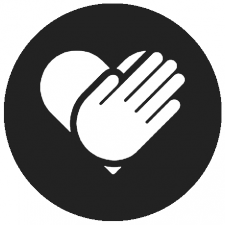 Black circular icon with white graphic of a hand in front of a heart