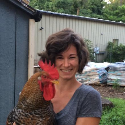 A closeup of Kelly Franklin holding a rooster.