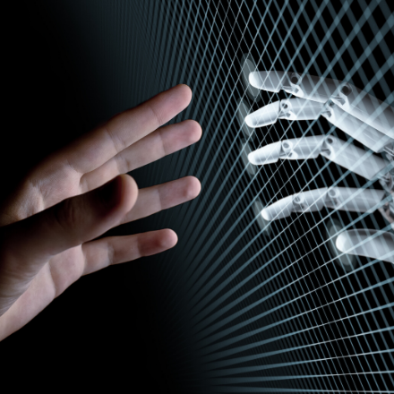 A human hand and a robot hand extended
