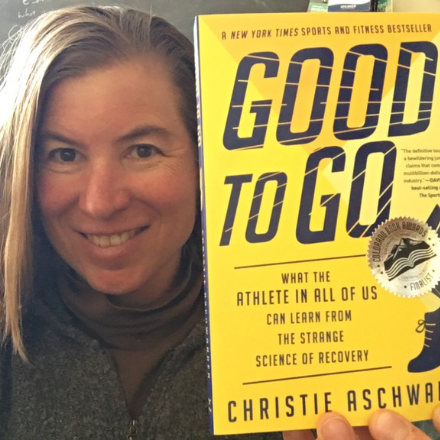 """Author Christie Aschwanden poses with her book """"Good to Go"""""""