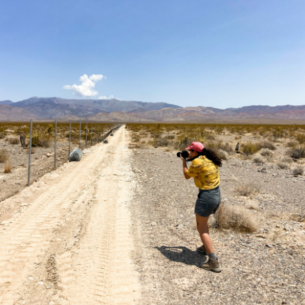 Science journalist Stephanie Castillo takes a photo in the desert